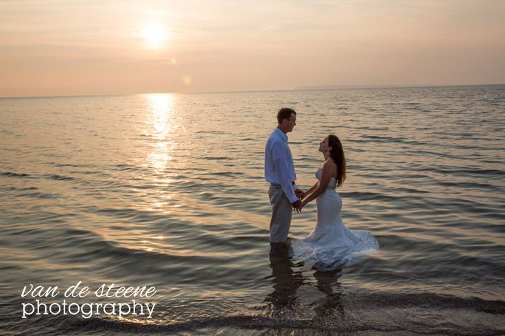 Nadia Stohrer & Mike Stohrer's northern Michigan wedding at The Homestead Resort. Running into Lake Michigan!