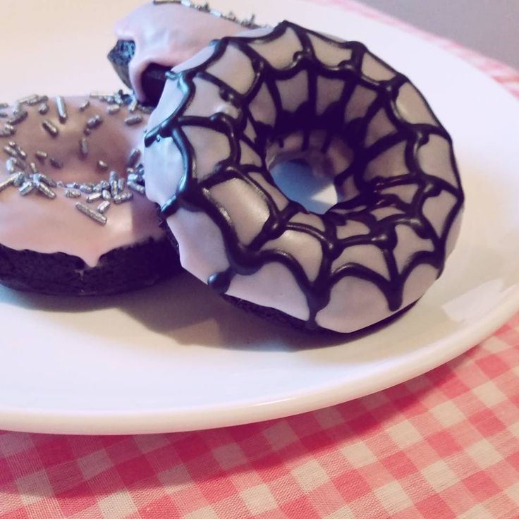 """""""Spider bakesale! Made by spiders, with spiders, for spiders. Black cocoa doughnuts with fondant glaze!  #donuts #doughnuts #videogames #undertale…"""""""