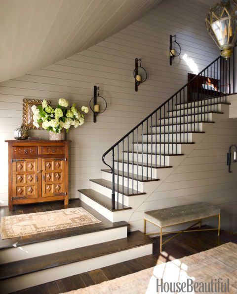 Minimal decorations along this stairwell give it a simple flair to match the neutral tone.