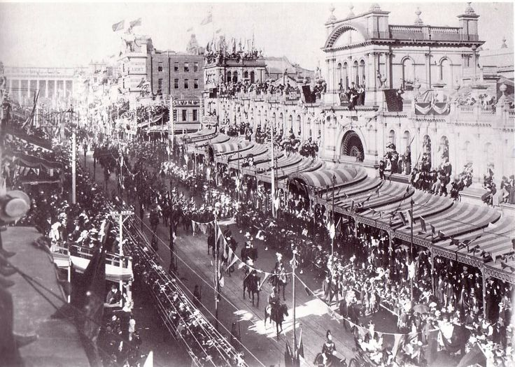 A military parade, possibly during the Boer War, passing the old Eastern Markets in Bourke Street, Melbourne. In 'Market Blues' Sam visits the Eastern Markets with Flea and his friends. The Eastern Markets were demolished in 1960.