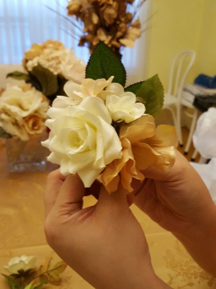 Homemade wedding boutinere with silk flowers.