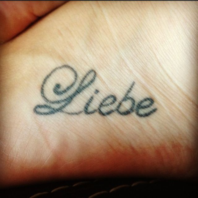 "My first Tattoo. It means ""Love"" in german which is my first language. My Mom and sister have the same tattoo which means the world to me."