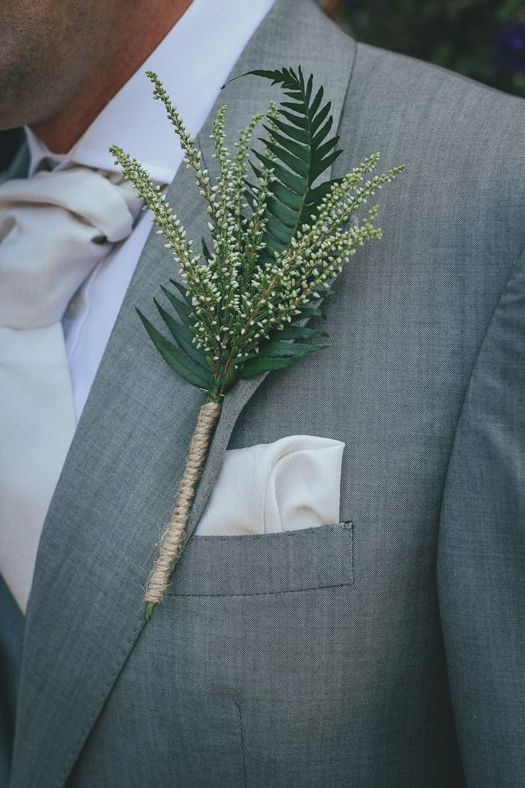 Greenery Buttonhole wrapped in Twine | Lace Augusta Jones Dress | Summer Country Wedding | Outdoor Tipi Reception | Rustic Decor | Wild Flowers | Etsy Purple Bridesmaid Dresses | Festoon Lights | Helen Lisk Photography | http://www.rockmywedding.co.uk/eve-tim/