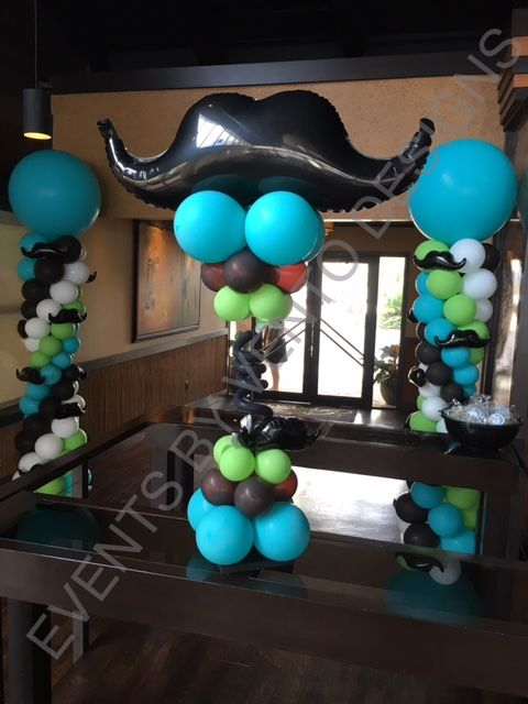 Mustache decorations make a difference and balloons on