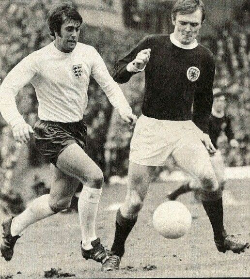 Scotland 0 England 0 in April 1970 at Hampden Park. Geoff Hurst and David Hay go for the ball #HomeChamp