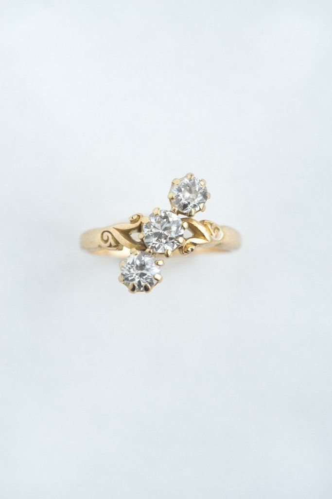 Old European Cut Diamond Trilogy Ring - A unique, bright, diagonal line of old European cut diamonds is prong-set here in 18k yellow gold. With scrolling sides leading to a simple band,we love this r - from QUITOKEETO.com