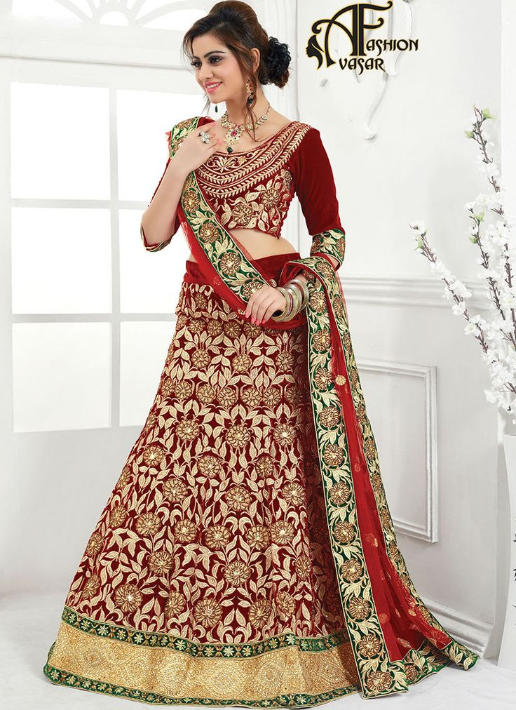 velvet lehenga online shopping.Looking great with attachment of Maroon Velvet Unstitched Lehenga Choli. This attire is nicely made with Crystals & Butta Work work.