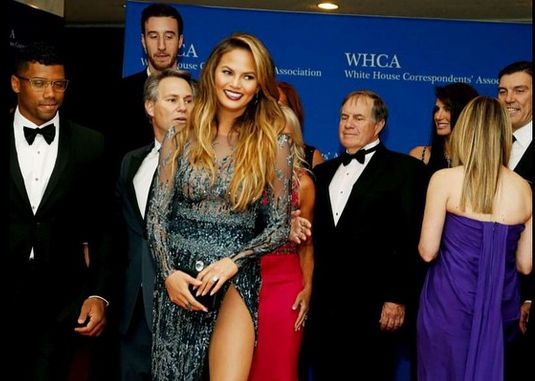 What are Bill Belichick and Chrissy Teigen looking at in this White House pic, hmm?