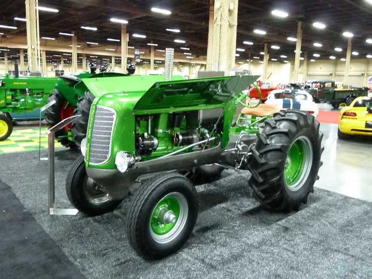 1948 Oliver Model 70 Tractor Custom; S/N ; Engine # 310906; Metallic Green, Silver frame/Tan vinyl; Customized restoration, 1 condition; Hammered Sold at 12,500 plus commission of 10.00%; Final Price 13,750 -- 24 inch drive wheels, chrome headlights. New tires. Custom paint and details. Done to consistently high standards of fit and finish. No Reserve. A custom farm tractor? And an Oliver at that? Amazing. It's worth the price it brought just to haul a trailer of kids in a parade.