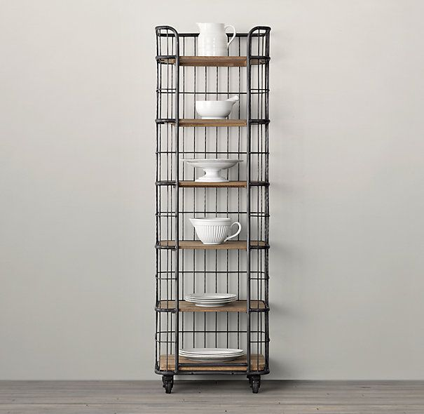 We've repurposed the design of a rolling baker's rack from the early 20th century, a time when commercial bakeries let their products rise, rest and cool on movable racks exactly like this. Its C-shaped frame was designed to help keep contents in place.