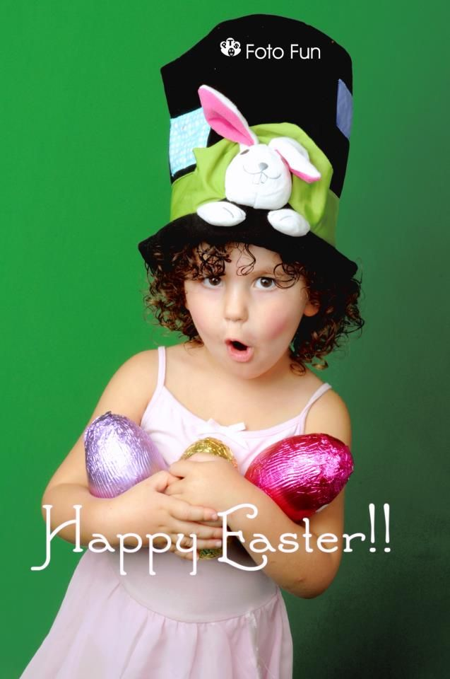 Little girl with rabbit hat and Easter eggs
