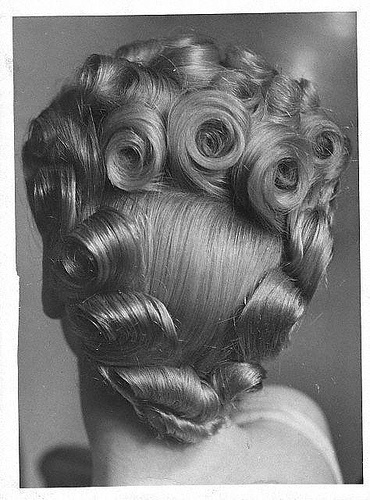 Betty Grable updo with piled up curls.