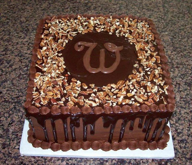 """Chocolate Grooms Cake - Chocolate Grooms Cake covered with ganache and pecans.  Topped with the """"W"""" initial."""