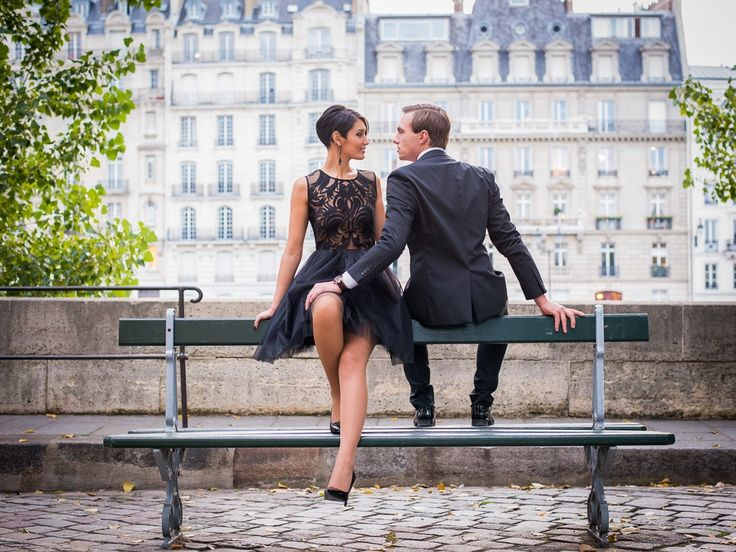 Urban city engagement shoot wearing classic black dress and suit, instant style!  Photograph: The Paris Photographer