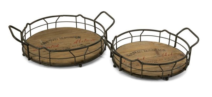 """Traineur Serving Trays - Set of 2 - Reminiscent of oak barrels used to age wine, the Traineur serving trays has antiqued logo graphics and wrought iron wine bottle holders. Material: 60% Wrought Iron, 40% Fir wood. 4.-4.5""""h x 14-16.25""""w x 11.5-13.25""""."""