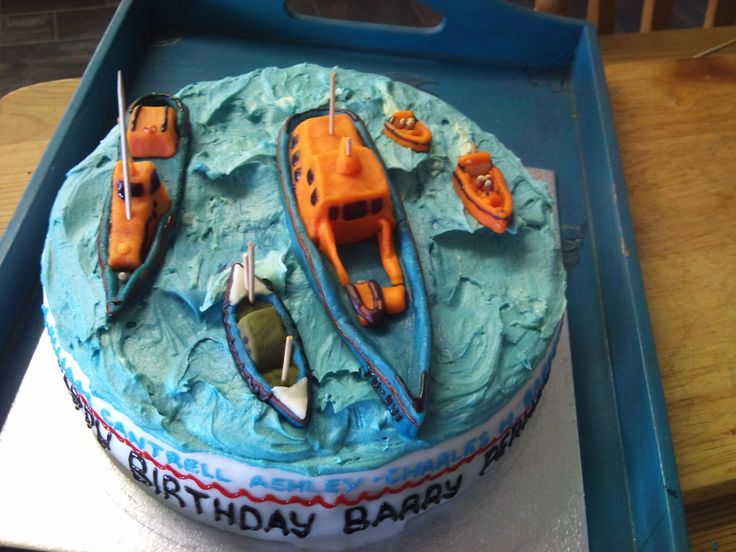 Barry Perham's 70th birthday cake - all the different Clovelly lifeboats he served with in his 52 years at the station!