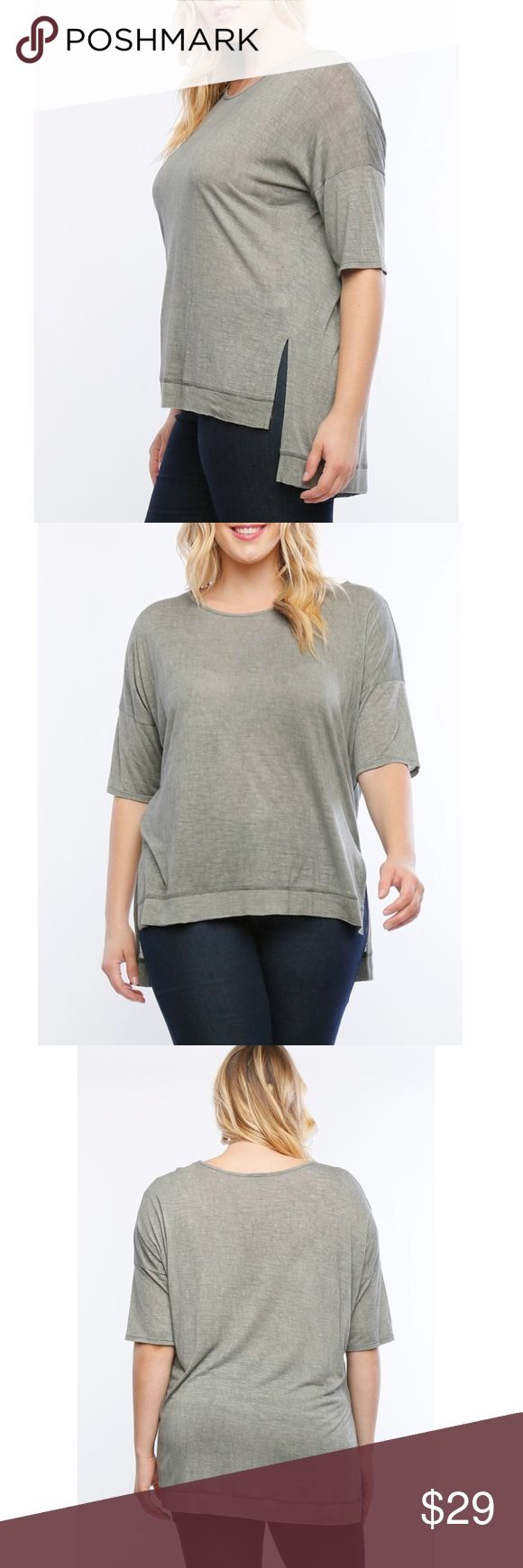 "Plus Size Mineral Wash Dolman Style Top Short sleeve dolman style mineral wash top with a slight high-low feature.  Stay comfortable, casual and cute by pairing this top with a great pair of skinny jeans and booties or wedges or dress it down with some shorts and sandals.   This top fits true to size, the model 5'10 and is shown in a 1XL. 100% Rayon 1XL Measures 26"" long from middle shoulder of wooden hanger to bottom, longer in the back, 2XL measures 27"" long in the front, 3XL measures 28""…"