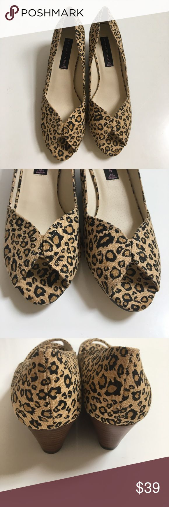 """NWOT { Steve Madden } leopard canvas wedges Steve Madden leopard print canvas low wedge, approx 2"""" heel, peep toe, new in great condition has minor storage wear and sole has a little marking from store and rub markings from trying to remove. These are very adorable and Cute. Steven by Steve Madden Shoes Wedges"""