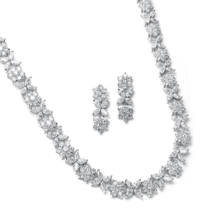 This stunning bridal necklace set features distinctive marquis CZ flowers for the look of platinum and diamonds.