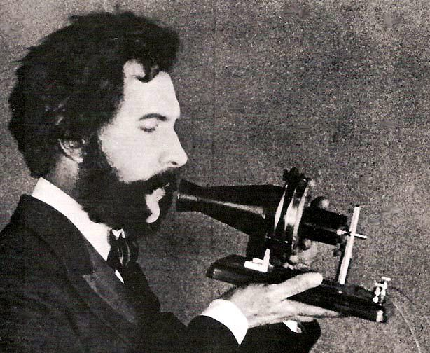 1876. Bell speaking into the telephone