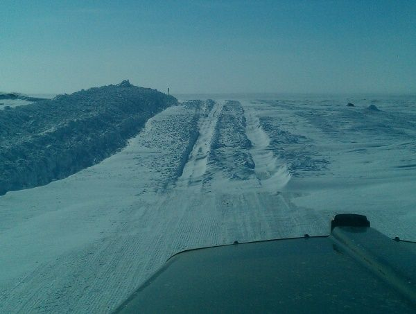 Snow Drifts Across The Ice Road On A Portage Above The Tree Line