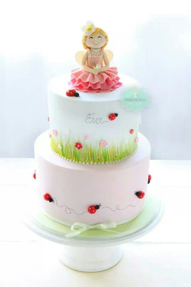 Cute two tier princess cake with ladybugs by Bake A Boo cakes.