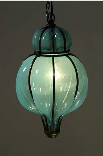 beautiful blown glass lantern. Love the color, like sea glass.