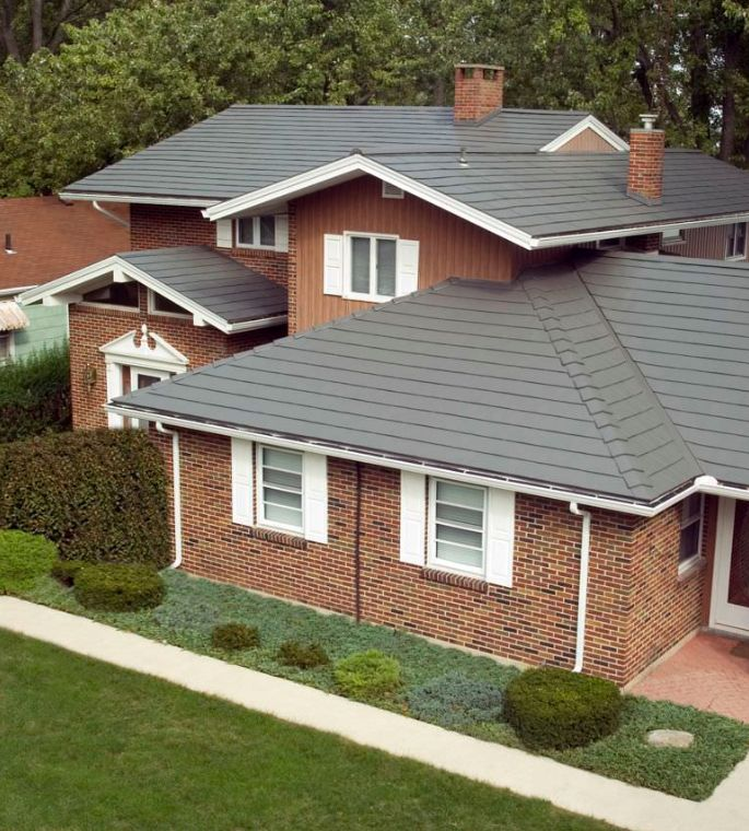 Gray metal roof on a brick home oxford aluminum shingle for Metal roof pictures brick house