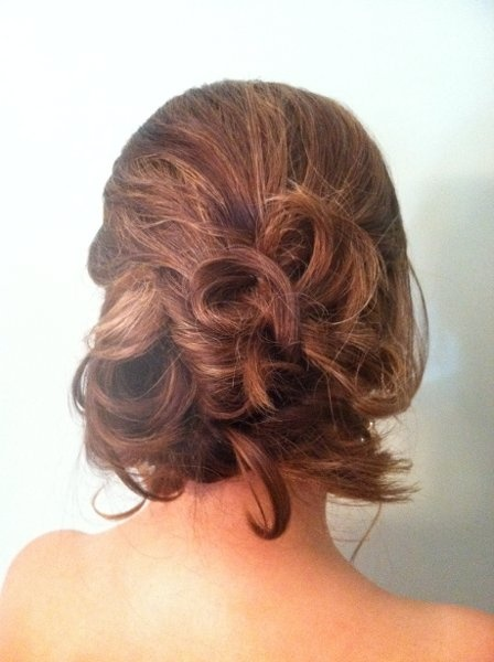 Relaxed updo on WeddingWire