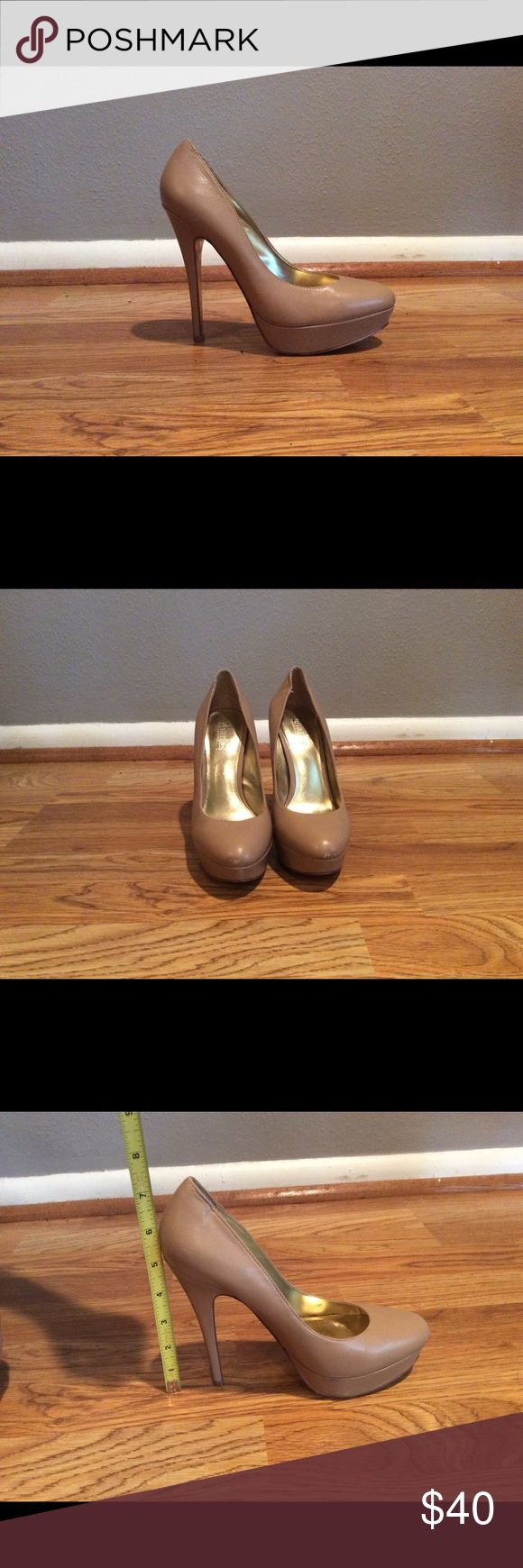 Charles David Nude platform heels size 7 Charles David Nude platform heels size 7. In good condition. There is a little wear on the toe. Easily fixed. These fit true to size. 4 inch heels. Charles David Shoes Heels