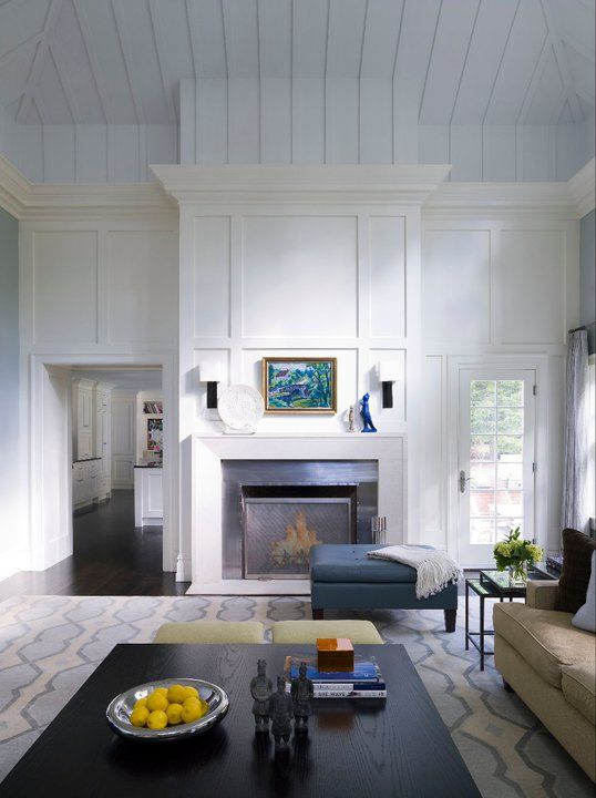 """Not a huge fan of the white """"wood"""" paneling on the ceiling, but I love the moulding around the fireplace."""