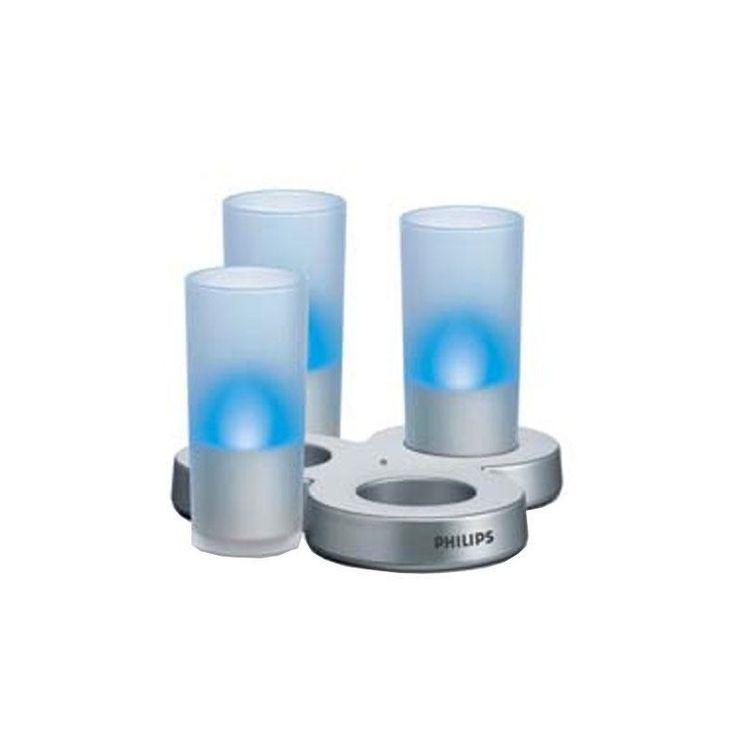 PHILIPS Conjunto de 3 velas eléctricas recarregáveis IMAGEO azuis  Graças à Philips, poderá jantar à luz das velas, sem temer queimar-se ou deixá-las cair, com o conjunto de três velas eléctricas recarregáveis IMAGEO azuis. Sem fios e oferecendo uma agradável luz cintilante, as velas eléctricas recarregáveis IMAGEO criam uma atmosfera agradável e festiva sem riscos: funcionam com um LED, sendo que não aquecem nem consomem energia! www.algarveshoppingonline.com