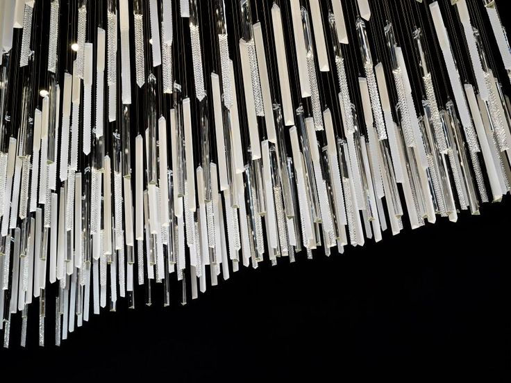 """Glass Rods. Imagine a wave of rods made from borosilicate glass hanging in the air. Some are clear, some matte, and some are treated with our special """"diamond cut"""". They are attached diagonally to the ceiling with cords to create a dynamic impact. #euroluce2015 #milandesignweek #salonedelmobile #light #design #interiordesign #glass #inspiration #luxury #decoration #style #preciosalighting"""