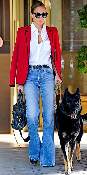 NICOLE RICHIE A bright-red contrast-trim blazer (Nicole's – worn over the shoulders, natch – is Saint Laurent) and flared jeans are so compatible, they should star in their own Match commercial.
