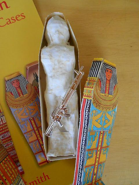 Mystery of History - Make a mummy out of an action figure.