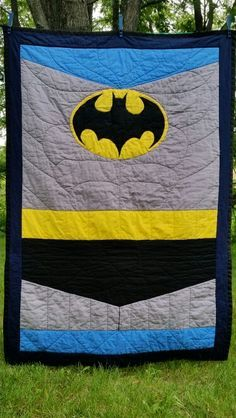 Just delivered this ! I made this Batman quilt for my friend's brand new tiny superhero! Love me a little batman! Oval and bat are appliqué, with his name stitched in black on the bat.