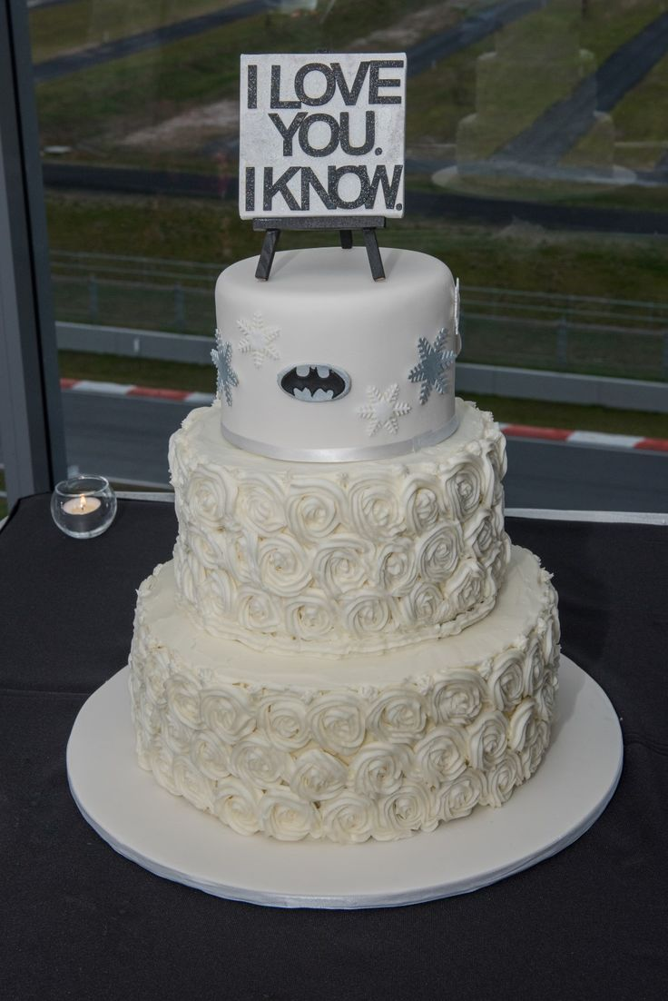 Wedding Photographer - Candid Photos of a Lifetime  3 tier wedding cake with topper (and batman !)