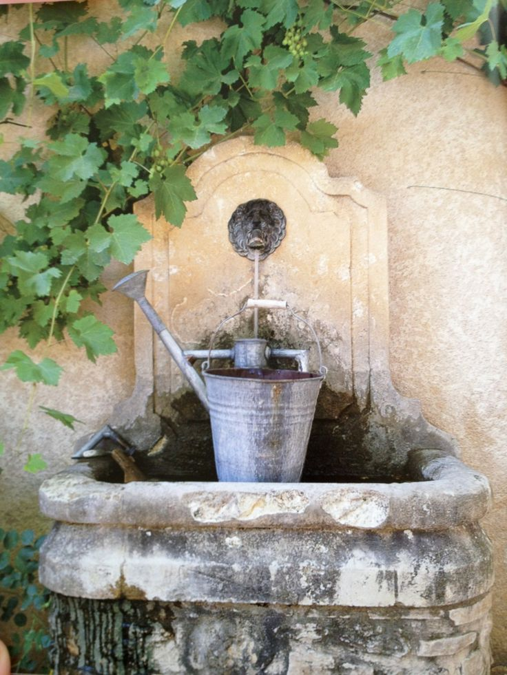 old stone fountain France