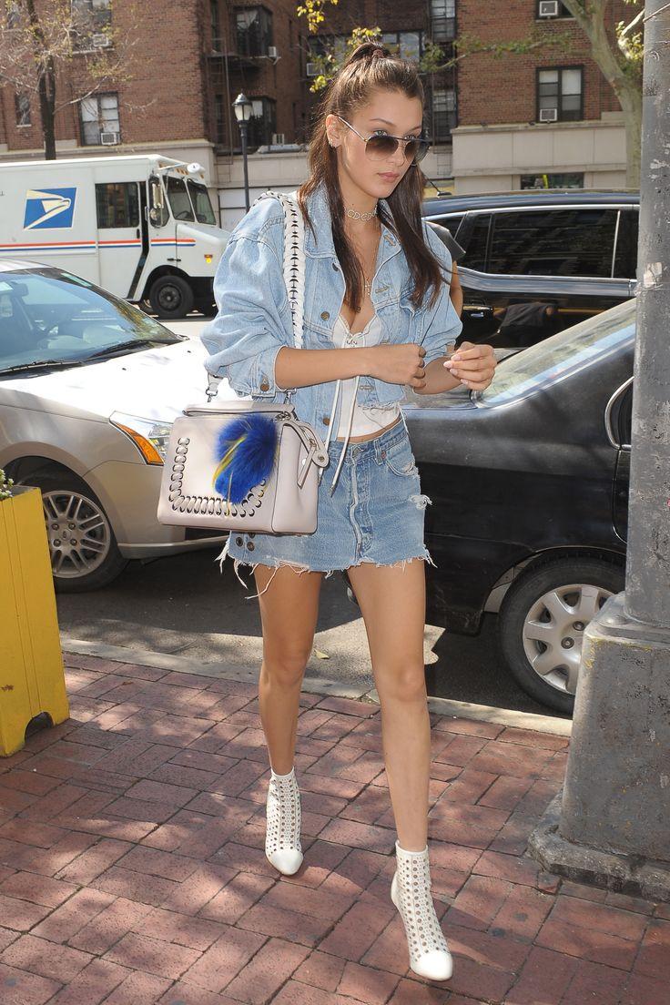 Bella Hadid completes her denim-on-denim look with her Fendi Dot Com bag and Fendirumi charm during New York Fashion Week.