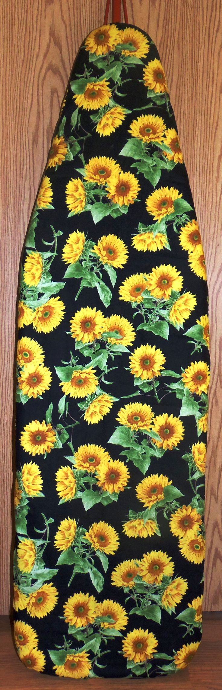 "Sunflowers - Farmhouse Ironing board cover Nice & Quick way to change the look of your Ironing Board. Great for displaying your antique Ironing Board. Standard board measures 54""x 15"" ~ Our covers measures - 59"" X 19.5"" Made of 100% cotton fabric, Adjustable drawstring for a good fit with 1"" Cord lock double hole, 3 little teeth in each hole to help grip your cord better, for easy on and off and quick adjusting string Machine wash cold - tumble dry low. Handmade in the USA"