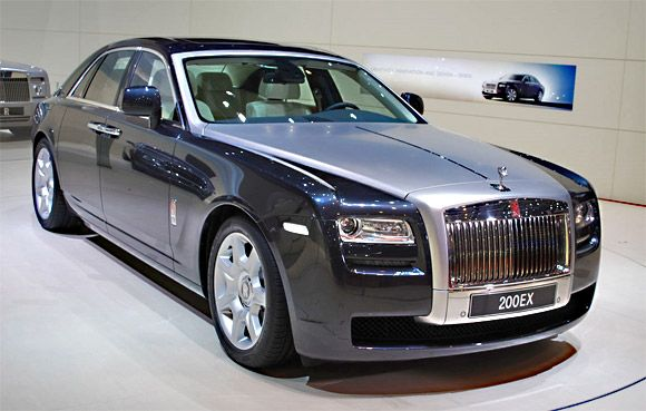 The Rolls Royce Ghost. Whereas it takes several machines 25-30 hours to build, the Ghost is hand-crafted and takes 400+ hours. The Ghost has a 6.6 Litre V12 engine. And it'll just set you back $352,000!!!! (Such a bargain!)