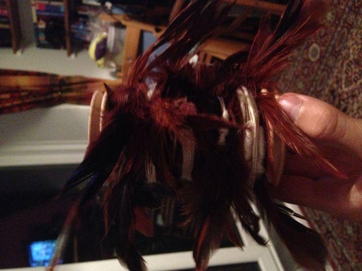 One sexy full feather yarn bobbin