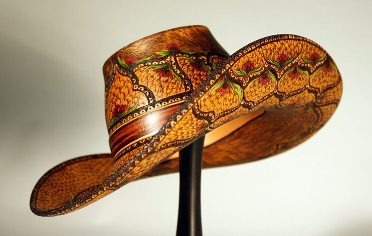 """Photo: Desperado Collaboration with outstanding Kentucky woodturner, +Chris Ramsey  This mini hat was skillfully turned from Bradford Pear by +Chris Ramsey. It was my desire to create a pyro-engraved embellishment that resembled tooled leather. India Ink was added for the color. A beautiful stand was created by Chris from Walnut trimmed with Honduran Rosewood Burl. 8"""" x 8"""" on stand.  More of my work can be see on my website: www.cynthiagibsonpyrography.com  The work of Chris Ramsey can be…"""