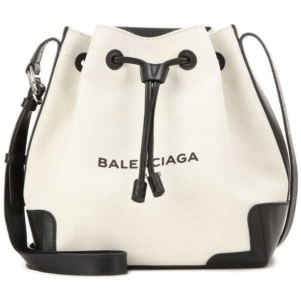 Balenciaga Canvas and Leather Bucket Bag ($1,170) ❤ liked on Polyvore featuring bags, handbags, shoulder bags, beige, hand bags, white leather purse, bucket bag, handbags purses and purse shoulder bag