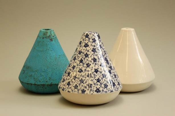 """The three-piece ceramic titled Dervish, shown above, captures the essence of what we associate with images of the 'whirling dervish' and combines both culture and spirituality. The viewer is engaged through the artist's use of shape, colour and texture. -     Idil is a recent graduate in Fine Arts from CoFa at the University of New South Wales. - Idil Abdullahi, """"Dervish"""" Ceramic Vessels"""