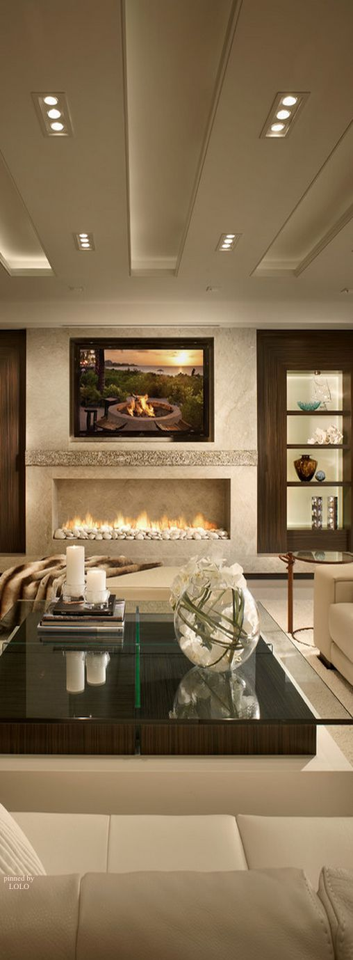 Barry Grossman Photography. Terrific fireplace and lighting in this wonderful living room.