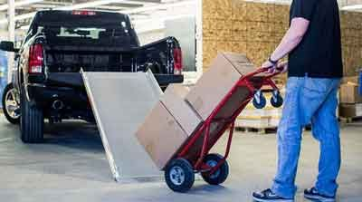 Loading ramps for Trucks or Pick ups.  http://www.portable-wheelchair-ramps.com/portable-ramps/traverse-loading-ramps.aspx
