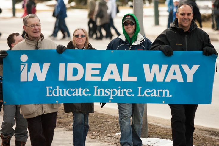 Proud uncles carrying the Ideal Way banner in the Walk of Inclusion 2014.