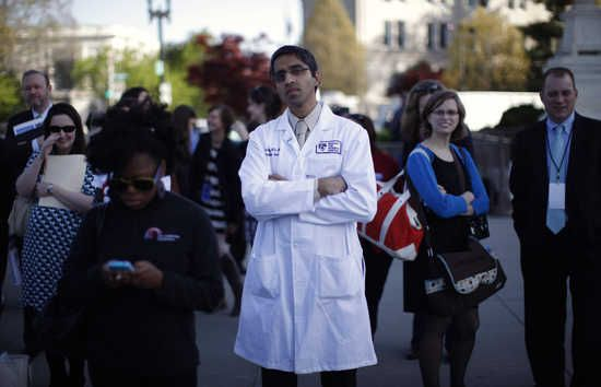 Republicans who blocked surgeon general nominee blame Obama for surgeon general vacancy Doctor Vivek Murthy stands among other bystanders during the first day of legal arguments over the Affordable Care Act outside the Supreme Court in Washington March 26, 2012. U.S. President Barack Obama's sweeping healthcare overhaul on Monday went before