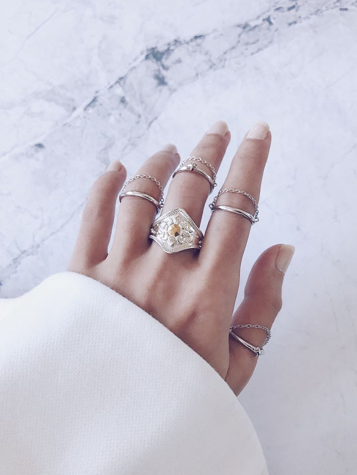 Learn how to stack your rings - A silver cocktail ring is perfect for anchoring the middle finger, while minimal chain rings add a modern touch, create a balanced ring stack by wearing on your midi and surrounding fingers. Love these unique stacking rings? SHOP NOW BY CLICKING WEBSITE LINK